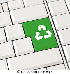 Green recycle icon on a computer keyboard with blank white...
