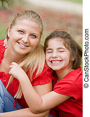 Mother Daughter in Red with Big Smiles