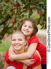 Mother Daughter in the Apple Orchard