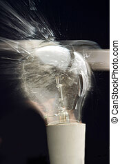 A light globe exploding - A stock photo of an incandescent...