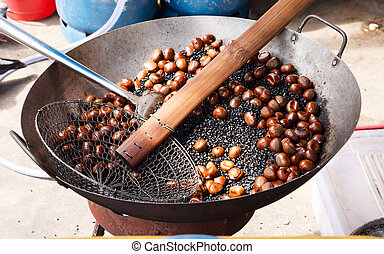 chestnuts in a pan  - roasting chestnuts in a pan