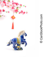 Ceramic horse souvenir on old paper,traditional chinese...