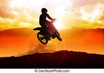 Motocross - Silhouette of a man figure riding a motocross