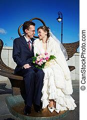 Bride and groom on wedding walk on Luzhkov bridge