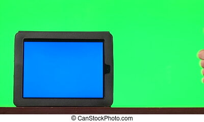 Man presenting digital tablet with a blue screen and...