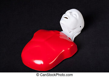 Plastic resuscitation phantom - A red and white plastic...