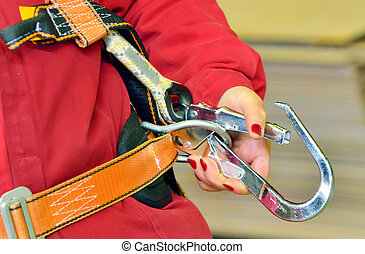 woman and a fall protection harness inside of factory
