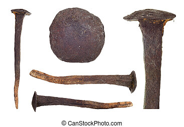 Set of rusty old big nails on white background. - Set of...
