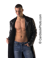 Attractive young man shirtless, wearing black leather trench...