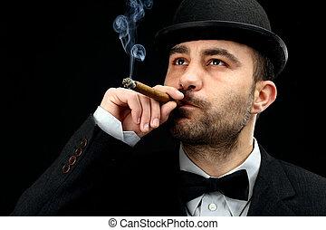 man smoking cigar - man with bowler hat smoking a  cigar
