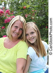 Friendly blond teenager with her mother - Friendly blond...