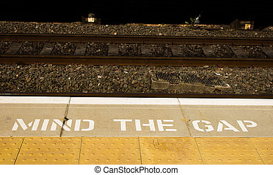 Mind the Gap Sign - A mind the gap sign