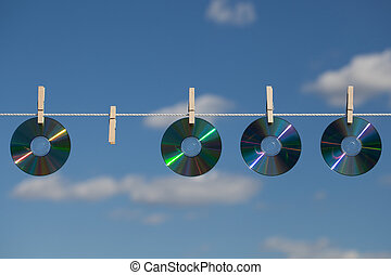 Four CDs On A Clotheslines - A missing CD in the row on a...