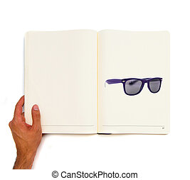 Glasses printed on white book