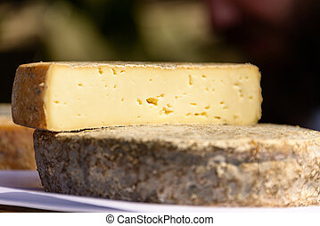 French tomme cheese - Half french tomme cheese on top of...
