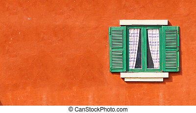 detail of a wooden window with shutters open on wall