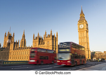 Big Ben and red buses - North face of Big Ben with houses of...