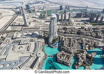 DUBAI, UAE - NOVEMBER 13: Aerial view of Downtown Dubai with man made lake and skyscrapers from the tallest building in the world, Burj Khalifa, at 828m, taken on 13 November 2013 in Dubai.