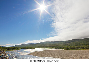 Tundra Landscape with river at sunny summer day