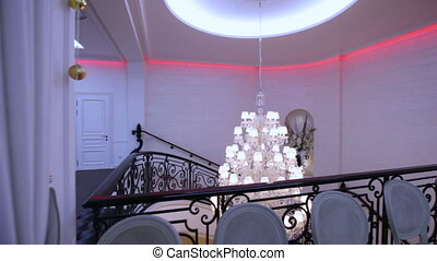 Chandelier for railings - Two elegant chandeliers flyby over...
