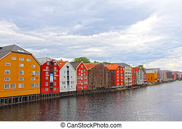Cityscape of Trondheim, Norway with old houses on embankment
