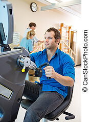 Young Man On Exercise Bike In Hospital - Young man on...