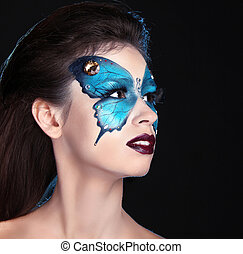 Face art portrait. Fashion Make up. Butterfly makeup on face...