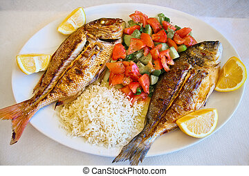 grilled gilt-head bream and red snapper served with mixed...