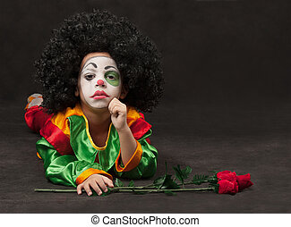 little boy, make-up of the clown, the African - little boy,...