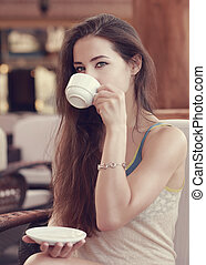 Beautiful thinking girl drinking coffee Closeup vintage...