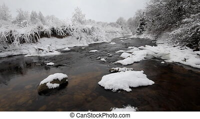 winter river and hoarfrost - the river in the winter, is a...
