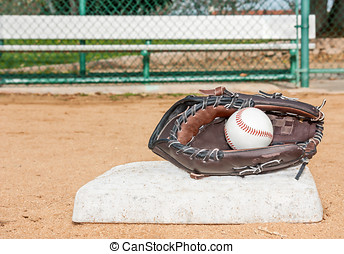Baseball mitt and ball at first base - Ball inside mitt Low...