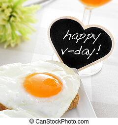 happy v-day - a heart-shaped fried egg on a toast and the...