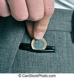man with euro coin - a man wearing a suit putting a one euro...