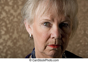 Skeptical Senior Woman - Closeup portrait of skeptical...