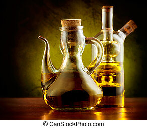 Olive Oil on the Table over Dark Background