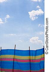 Striped Windbreak - Brightly coloured, striped windbreak,...