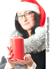 woman holds a candle