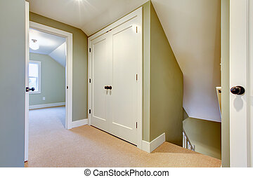 Bright hallway with built-in small storage room - White and...