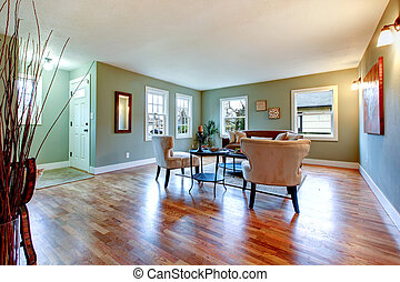 Large bright room with green walls and cherry hardwood. -...