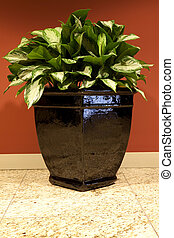 Indoor planter - Indoor planter with an artificial plant in...