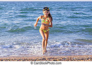 Happy girl runs from the sea - Happy little girl runs from...