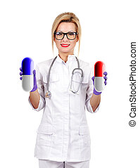 doctor holding two pills - female doctor holding two pills...