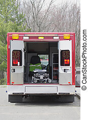 Ambulance - Red ambulance with the doors open and a...