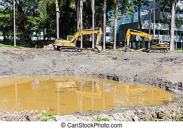Large Yellow Back Hoe at site