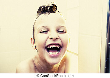 Shower - 6 years old girl takes a shower in the bathroom,...