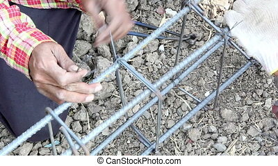 Workers tied wire metal for building construction