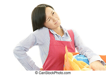 Woman with back pain - Tired and stressed housewife