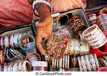 Close up of hand with bangels, Sadar Market, Jodhpur, India...