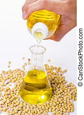 pouring yellow soya bean oil into test tube glass